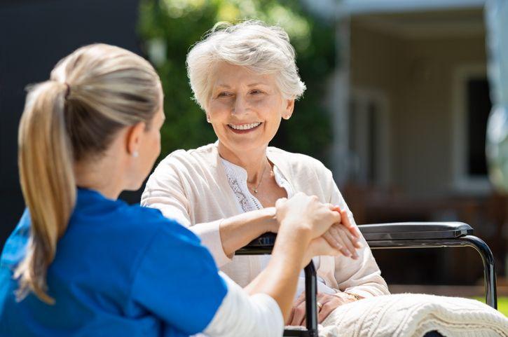 nurse with old patient analisi cliniche caserta cerasole